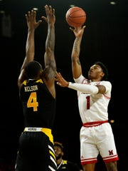 Miami (Oh) Redhawks guard Nike Sibande (1) puts up a shot over Northern Kentucky Norse forward Adrian Nelson (4) in the first half of the NCAA basketball game between the Miami (Oh) Redhawks and the Northern Kentucky Norse at Millet Hall in Oxford, Ohio, on Tuesday, Dec. 3, 2019. The Norse led 29-22 at halftime.