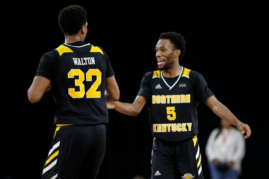 Northern Kentucky Norse guard Bryson Langdon (5) and forward Dantez Walton (32) celebrate an assist and basket in the second half of the NCAA basketball game between the Miami (Oh) Redhawks and the Northern Kentucky Norse at Millet Hall in Oxford, Ohio, on Tuesday, Dec. 3, 2019. The Norse picked up a win on the road, 76-54.