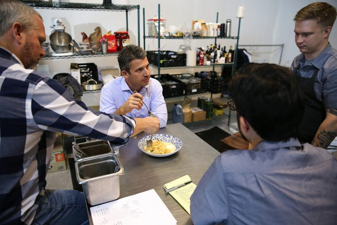 Thunderdome Restaurant Group co-owner Joe Lanni (center) tasting a dish for the group's new restaurant, Pepp & Dolores, Friday, Oct. 18, 2019, in the company's unofficial test kitchen at Maplewood Kitchen in Cincinnati.