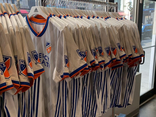 """FC Cincinnati on Tuesday unveiled its new Adidas """"Heritage Link"""" tops for away matches. The shirts, which feature a pop of orange and blue and several nods to the City of Cincinnati, went on sale to the general public at 10 a.m."""