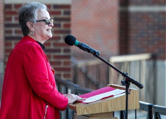 APSU's President Alisa White stands at the podium and announces the record enrollment number at Morgan University Center Plaza in Clarksville, Tenn., on Wednesday, Dec. 4, 2019.