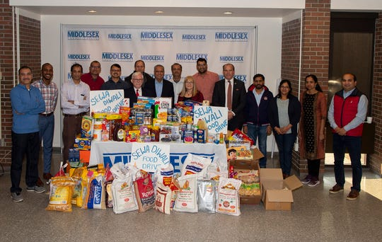 Hindu Swayamsevak Sangh USA participated in a Sewa Diwali food drive aimed to promote community service, especially among youth. The effort started within the state's Hindu community last year and expanded to nine other states to include more than  1,000 volunteers representing 65 organizations. In 2018, about 17,000 pounds of food was collected and donated to various charities in New Jersey. This year, more than 50,000 pounds was collected and is being distributed; 30,000 of it in New Jersey. Middlesex County College food pantry received about 2,500 pounds of food. Members of the club are shown with college President Mark McCormick (center with red tie), state Board of Public Utilities Commissioner Upendra Chivukula to his right and, next to him, Kathy Shay, a retired faculty member and founder of the the college's pantry. Visit sewadiwali.org/ and hssus.org/.