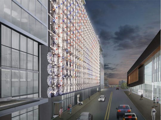 A rendering shows the proposed artwork for the west side of the parking ramp for The Fifth. The moving art piece, created by Yorame Mevorach, also known as Oyoram, includes 454 turbines and more than 900 LED lights.