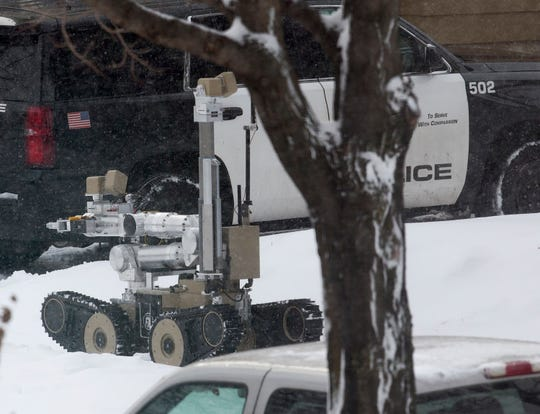 A robot is used as authorities respond to the scene of a shooting Sunday, Dec. 1, 2019, in Minneapolis. Four people, former Hoyt Sherman Place executive director David Schladetzky, his ex-wife and two sons, died after an an incident at the home that police have called a triple-homicide and a suicide.