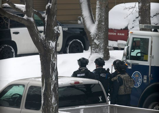 Authorities respond to the scene of a shooting Sunday, Dec. 1, 2019, in Minneapolis.  Four people, former Hoyt Sherman Place executive director David Schladetzky, his ex-wife and two sons, died after an an incident at the home that police have called a triple-homicide and a suicide.