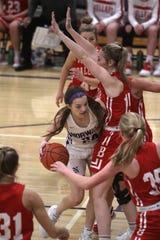 Norwalk sophomore Jocelyn Bice runs into a wall of Ballard defenders. Norwalk lost at home to Ballard 56-25 on Dec. 3.
