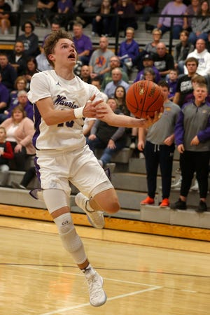 Norwalk senior Bowen Born takes the ball to the basket. Norwalk beat Ballard 79-52 in a season-opening home game on Dec. 3.