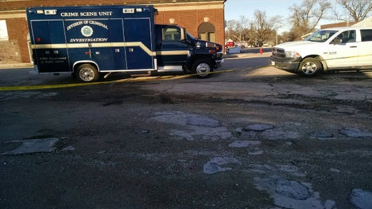 Authorities investigate a killing that they believe occurred during a bank robbery Wednesday, Dec. 4, 2019, at Security State Bank in Lu Verne in northern Iowa.