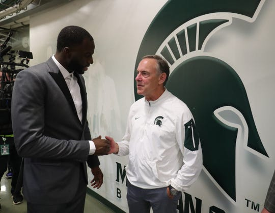 Draymond Green and Mark Dantonio talk after his Michigan State Spartans number 23 was retired during half time of the game against the Duke Blue Devils Tuesday, December 3, 2019 at the Breslin Center in East Lansing, Mich.