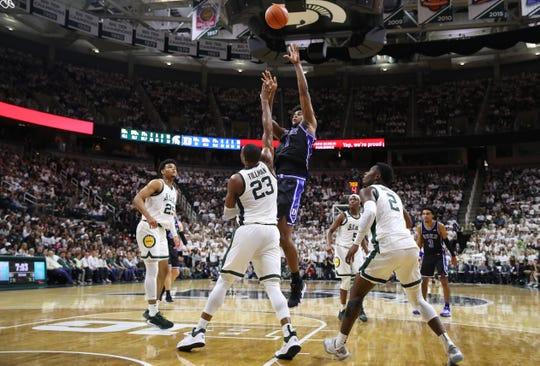 EAST LANSING, MICHIGAN - DECEMBER 03: Vernon Carey Jr. #1 of the Duke Blue Devils takes a shot over Xavier Tillman #23 of the Michigan State Spartans during the second half at Breslin Center on December 03, 2019 in East Lansing, Michigan. Duke won the game 87-75. (Photo by Gregory Shamus/Getty Images)