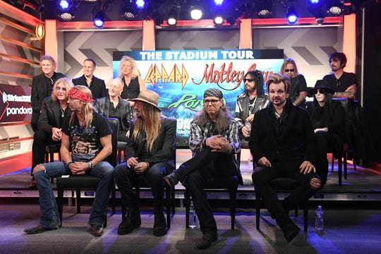 Motley Crue, Def Leppard and Poison announced 2020 Stadium Tour on Dec. 4, 2019 in Hollywood. Back of stage, left to right: Rick Allen, Joe Elliott, Vivian Campbell, Phil Collen, and Rick Savage of Def Leppard; Nikki Sixx, Vince Neil, Mick Mars, and Tommy Lee of Motley Crue. Front of stage, left to right Bret Michaels, C.C. DeVille, Bobby Dall, and Rikki Rockett of Poison.