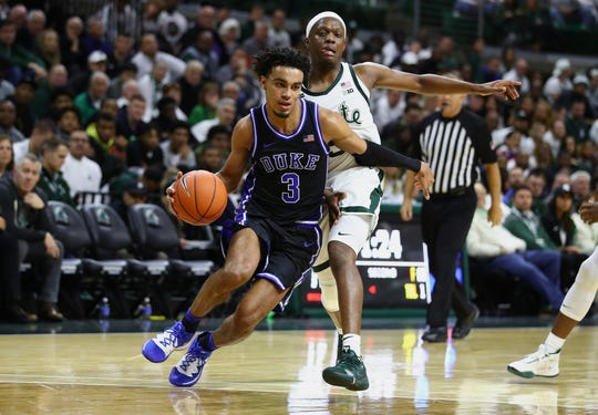 EAST LANSING, MICHIGAN - DECEMBER 03: Tre Jones #3 of the Duke Blue Devils tries to control the ball in front of Cassius Winston #5 of the Michigan State Spartans during the second half at Breslin Center on December 03, 2019 in East Lansing, Michigan. Duke won the game 87-75. (Photo by Gregory Shamus/Getty Images)