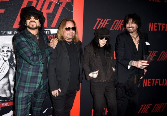 "Nikki Sixx, Vince Neil, Mick Mars and Tommy Lee of Motley Crue arrive at the premiere of Netflix's ""The Dirt"" at ArcLight Hollywood on March 18, 2019, in Hollywood. (Photo by Kevin Winter/Getty Images)"