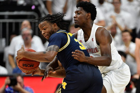 Dec 3, 2019; Louisville, KY, USA; Louisville Cardinals guard Darius Perry (2) defends against Michigan Wolverines guard Zavier Simpson (3) during the second half at KFC Yum! Center.  Louisville defeated Michigan 58-43.  Mandatory Credit: Jamie Rhodes-USA TODAY Sports