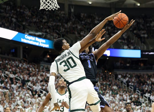 Dec 3, 2019; East Lansing, MI, USA; Michigan State Spartans forward Marcus Bingham Jr. (30) blocks the shot of Duke Blue Devils center Vernon Carey Jr. (1) during the first half of a game at Breslin Center. Mandatory Credit: Mike Carter-USA TODAY Sports