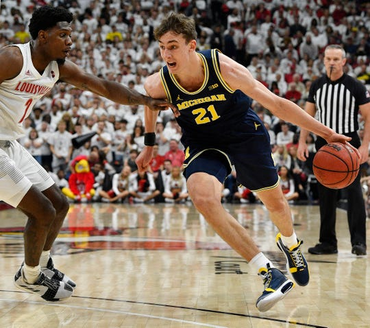 Michigan's Franz Wagner dribbles against Louisville on Tuesday.
