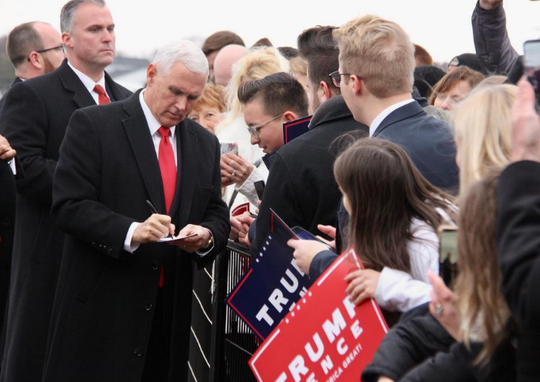 Vice President Mike Pence signs an autograph for a supporter Wednesday, Dec. 4, 2019, after arriving at Kalamazoo/Battle Creek International Airport.