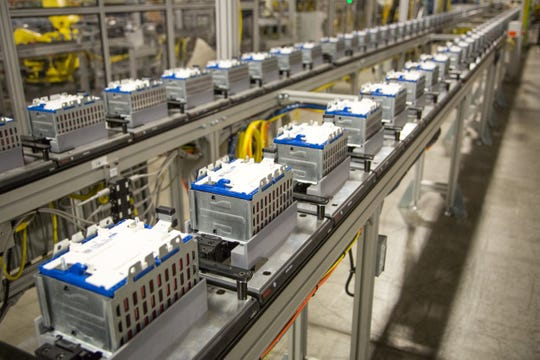 Battery cell modules travel down the line to be assembled into eAssist and hybrid electric vehicle packs at the GM Brownstown Battery Assembly Plant in Brownstown Township. The facility assembles six different batteries supporting nine GM vehicles.
