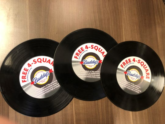 Buddy's vinyl records will placed around town starting Wednesday, Dec. 4. If you find one you get a free pizza.