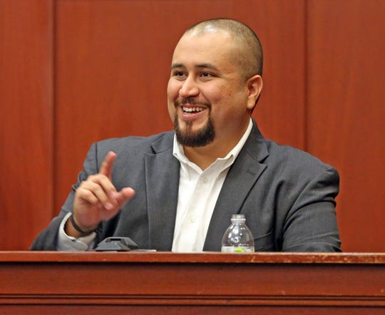 George Zimmerman smiles as he testifies in a Seminole County courtroom in Orlando, Fla. on Sept. 13, 2016.