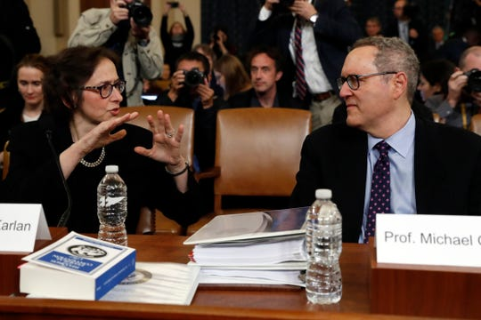 Constitutional law experts Stanford Law School professor Pamela Karlan talks with University of North Carolina Law School professor Michael Gerhardt as they arrive to testify during a hearing before the House Judiciary Committee on the constitutional grounds for the impeachment of President Donald Trump, Wednesday, Dec. 4, 2019.