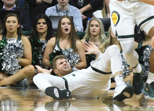Michigan State guard Kyle Ahrens gets knocked to the floor in the second half.