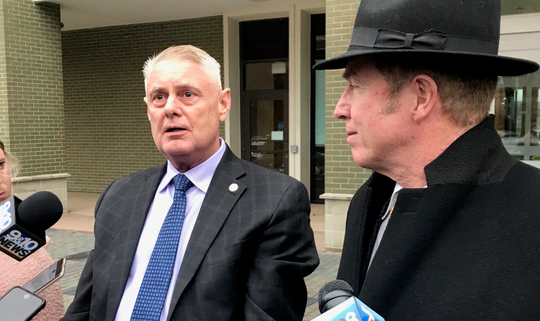 Rep. Larry Inman, left, and his attorney, Chris Cooke, answer questions on Wednesday, Dec. 4, 2019, after the second day of Inman's trial in Grand Rapids.