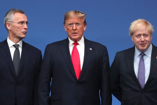 NATO Secretary General Jens Stoltenberg, left, and British Prime Minister Boris Johnson, right, welcome U.S. President Donald Trump during a NATO leaders meeting at The Grove hotel and resort in Watford, Hertfordshire, England.