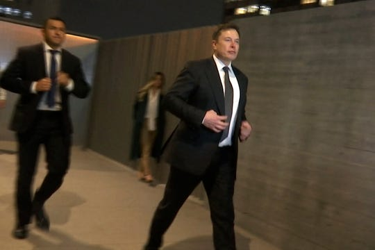 Tesla CEO Elon Musk leaves court, Tuesday, Dec. 3, 2019, in Los Angeles.