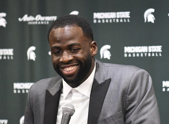 Former Michigan State basketball player Draymond Green speaks to the media before the Spartans played a game against Duke University at Breslin Center in E. Lansing, December 3, 2019.  Green, who played for Michigan State from 2008-2012, had his number retired during a halftime ceremony.