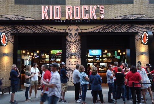 A line forms at Kid Rock's restaurant on the main concourse at Little Caesars Arena before a Red Wings preseason game on September 23, 2017.
