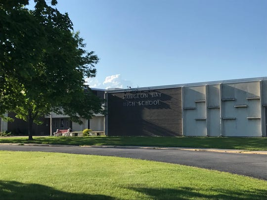 Sturgeon Bay High School students are safe after a student who posted a threatening message on social media was taken into police custody Tuesday.