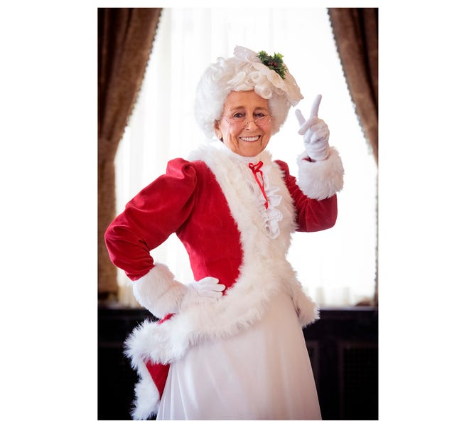 Betty Farr, pictured here at the Westin Poinsett in downtown Greenville, has been dressing up as Mrs. Claus for 60 years.