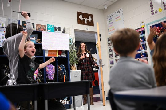 Jessica Patterson of Chastain Road Elementary School walks into a cheering classroom Wednesday, Dec. 4, 2019, during the surprise announcement that she is this year's South Carolina Elementary School Principal of the Year.