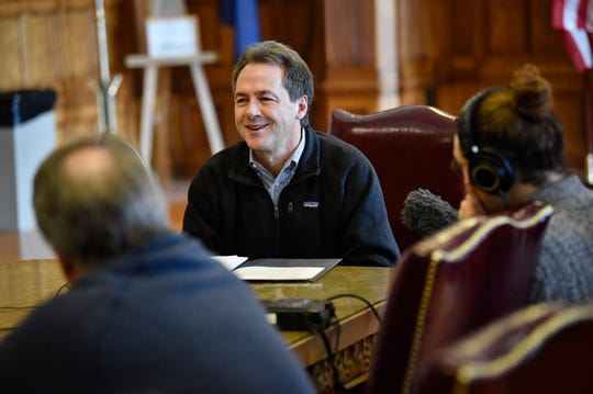 Gov. Steve Bullock talks with reporters Wednesday in the state Capitol in Helena.