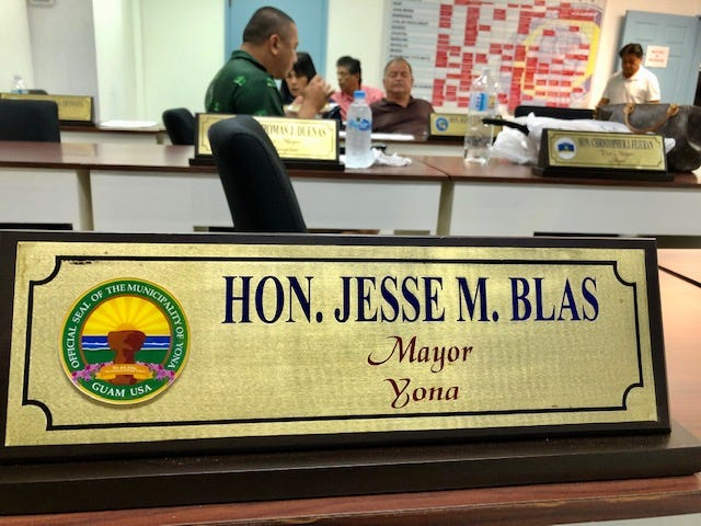 Yona Mayor Jesse Blas' empty desk at the Mayors' Council of Guam office during the council's meeting on Dec. 4, 2019. The council sent two draft resignation letters to Blas, after he indicated considering stepping down, mayors said.