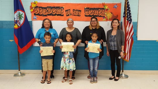Guahan Academy Charter School's  October Student of the Month awardees on Nov. 21. Pictured from left in front row: Caleb Ongesel, Isabella Pillias and Ellena Rokop. Pictured in back: Mary Mafnas, dean of Elementary Guahan Academy Charter School; Doria Villagomez; Nikki Java and Lynda Hernandez-Avilla, dean of Secondary Guahan Academy Charter School.