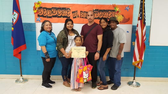 Guahan Academy Charter School's October Student of the Month on Nov. 21. Pictured in front row: Zaniyahserenity Borja, Mary Mafnas, Nadine Perez, John Borja, Mary and Junior Perez.