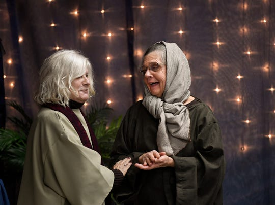 "Playing the part bakers in the village, Harriet Williams, left, and Myra Braden share a laugh during a dress rehearsal of the Cairo United Methodist Church's production of ""Journey to Bethlehem"" Tuesday evening. The popular event regularly draws as many as 1,000 people to participate in a re-creation of the village of Bethlehem, December 3, 2019."
