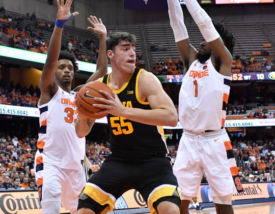 Luka Garza (55) dominated inside at the Carrier Dome on Tuesday night.