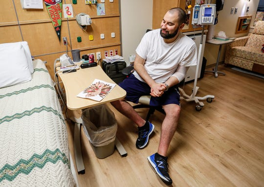 Travis Ballard, 38, born with a congenital heart defect, looks at his foot turkey painting, Indianapolis, Tuesday, Nov. 26, 2019. Ballard and Steven Smith who has the same congenital heart defect, have been waiting at Riley Hospital for Children for 152 days for a heart transplant.