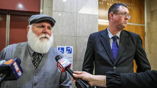 Michael C. Thompson, left, the nephew of infamous bank robber John Dillinger, and Thompson's son Travis Thompson, right, speak out after a hearing at the City-County Building regarding Dillinger's exhumation,  Wednesday, Dec. 4, 2019. Michael C. Thompson filed a lawsuit in August after Crown Hill Cemetery voiced its opposition to digging up Dillinger's body.