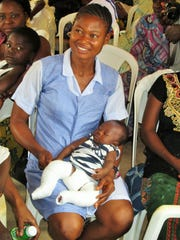 Tom Cook took this photo of a nurse holding a baby following application of plaster casts to correct clubfoot in Gboko, Nigeria a few years ago. About half of the children born with clubfoot have the disability in both feet, as does this child.