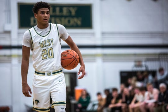 Iowa City West guard Marcus Morgan (20) gets ready to shoot a free throw during a Class 4A boy's basketball game, Tuesday, Dec. 3, 2019, at West High School in Iowa City, Iowa.