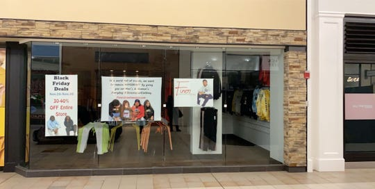 Exterior of Finer Streetwear Co. in the temporary Coral Ridge Mall Black Friday weekend store front for his business.