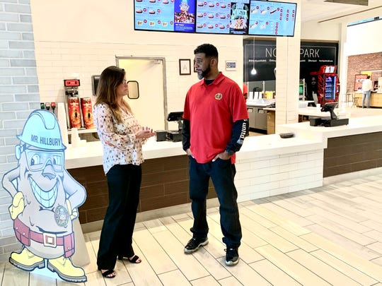 Kasey Dickson, manager at Northpark, chats with Michael Joyner, a franchisee of The Stuffed Baked Potato Factory, a new addition to the Northpark's food court.