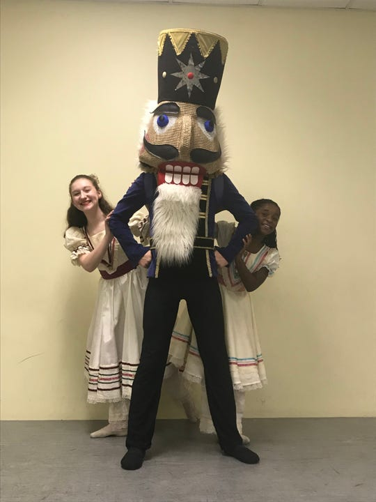 Mimi Atkisson (left) and Mackenzie Winters portray Clara in The Nutcracker. Parker Roe will be in the title character's costume.