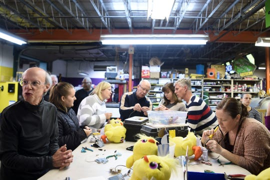 Volunteers and members of Knox Makers rewire electronic toys on Tuesday, December 3, 2019 to make them easier to operate for children with disabilities. The Toy Adaption Night event is to benefit Spark, an organization that helps connect people with disabilities to adaptive technology.