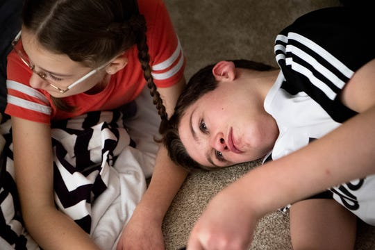 Ethan Woodruff, 13, plays with his sister Kate, 10, at their home Tuesday, Nov. 26, 2019 in Nashville, Tennessee.