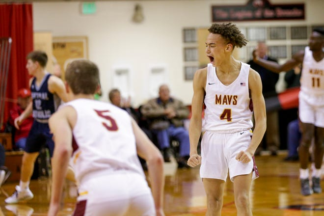 McCutcheon's Dravyn Lawhorn (4) reacts after a three point basket from McCutcheon's James Mallett (11) during the first period of overtime in game three of the 2019 Boys Hoops Classic, Tuesday, Dec. 3, 2019 in Lafayette.